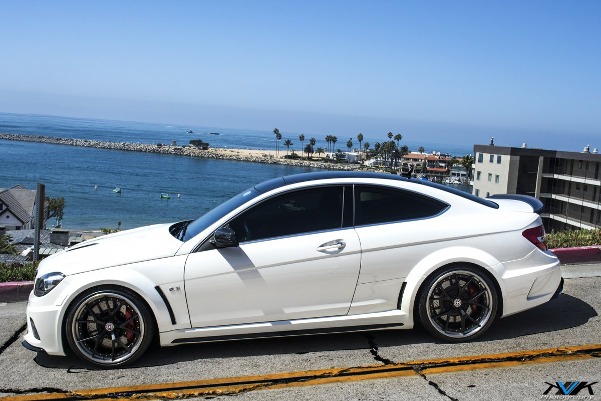 gleaming white mercedes benz c63 amg black series is aggressively perf. Black Bedroom Furniture Sets. Home Design Ideas
